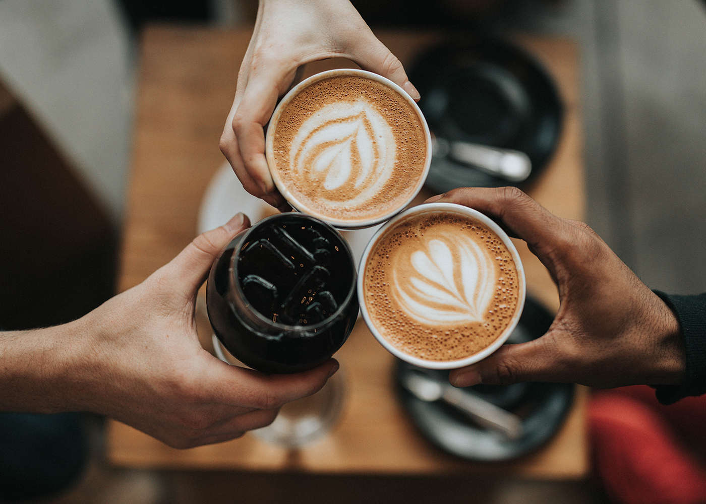 people holding cups of Coffee